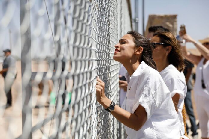 AOC STAGED FENCE EVENT